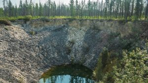 A large sinkhole at the Angus Fire Tower and day-use area in Wood Buffalo National Park along Highway 5 in August 2021. Sarah Pruys/Cabin Radio