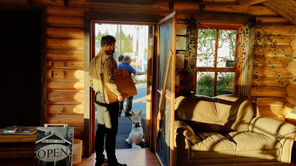Roland Laufer, Green Party candidate in the NWT, and Laufer's dog, Duchess, prepare for a meet-and-greet event at Yellowknife's Wildcat Café in September 2021