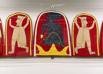 Jessie Oonark's wool-and-felt wall hangings appear within protective plexiglass at the Yellowknife Courthouse