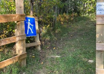 Posts at a trailhead on Smith's Landing First Nation were sawed off in September 2021