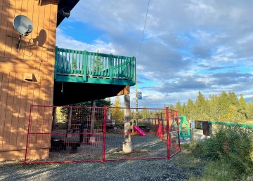 Yellowknife's ski club chalet with a red fence denoting the extent of the makeshift isolation centre