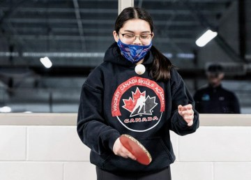 A participant in a pilot program that develops hockey goalies' skills using table tennis